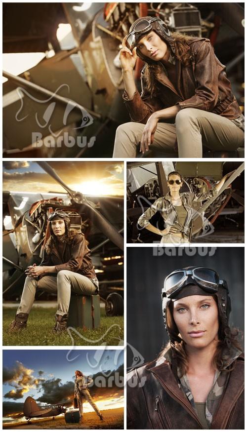 Girl pilot and plane / Девушка летчик и самолет  - Photo stock