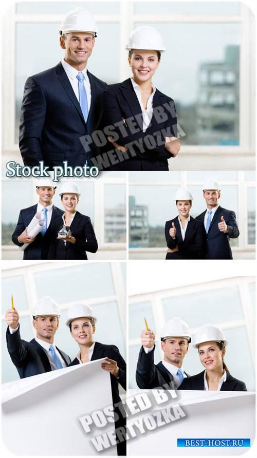 Мужчина и женщина архитекторы / Man and woman architects - stock photos