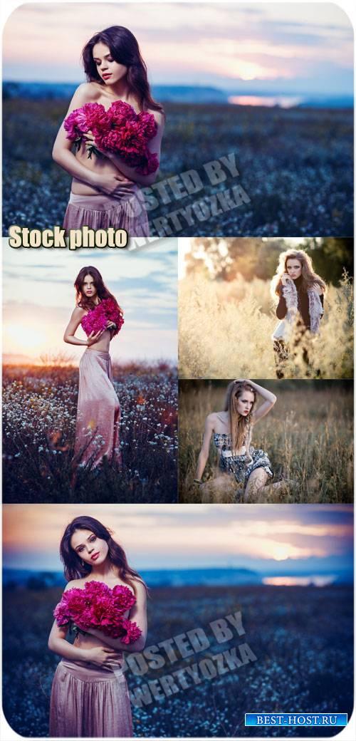 Девушки в поле с цветами / Girls in a field with flowers - stock photo