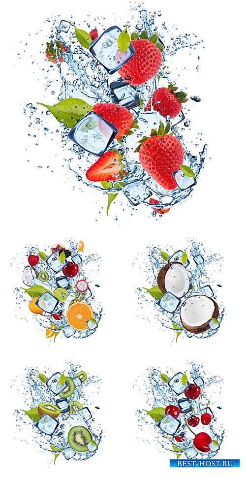 Фрукты и ягоды в брызгах воды и кусочках льда / Fruits and berries in a spray of water - Stock photo