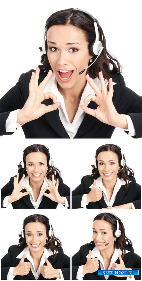 Молодая женщина оператор, девушка в наушниках / Young woman operator - Stock Photo