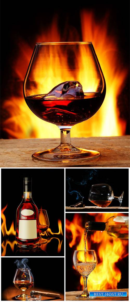 Cognac, bottle and glasses of cognac - Stock Photo