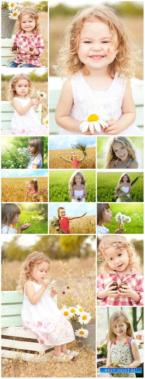 Little girls on the nature - Stock Photo