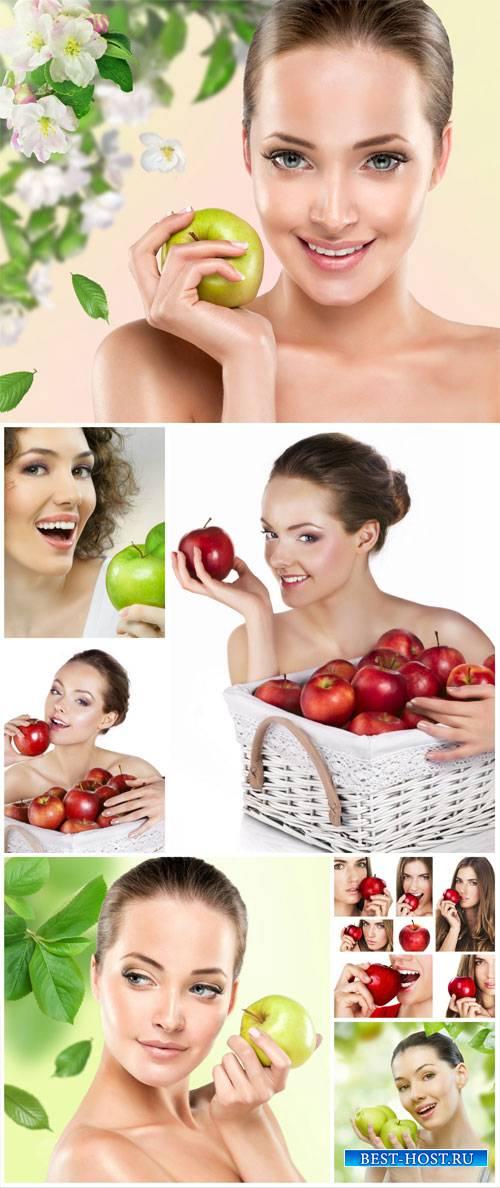 Beautiful girls with apples - stock photos