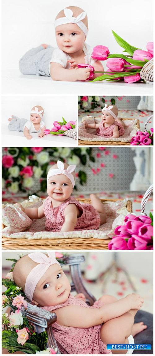 Little kid with tulips - stock photos