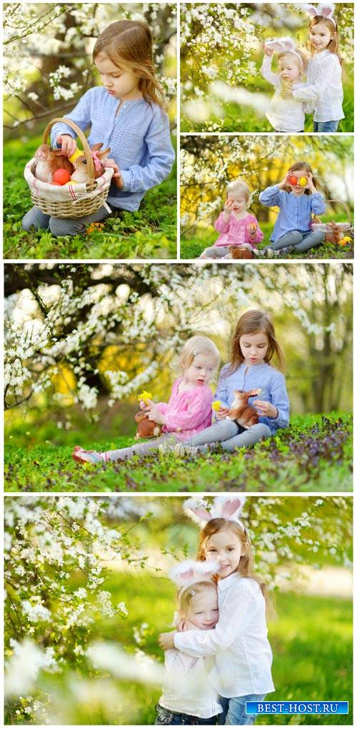 Children in the spring garden, Easter - stock photos