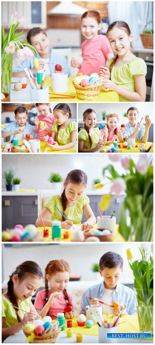 Children paint easter eggs - stock photos