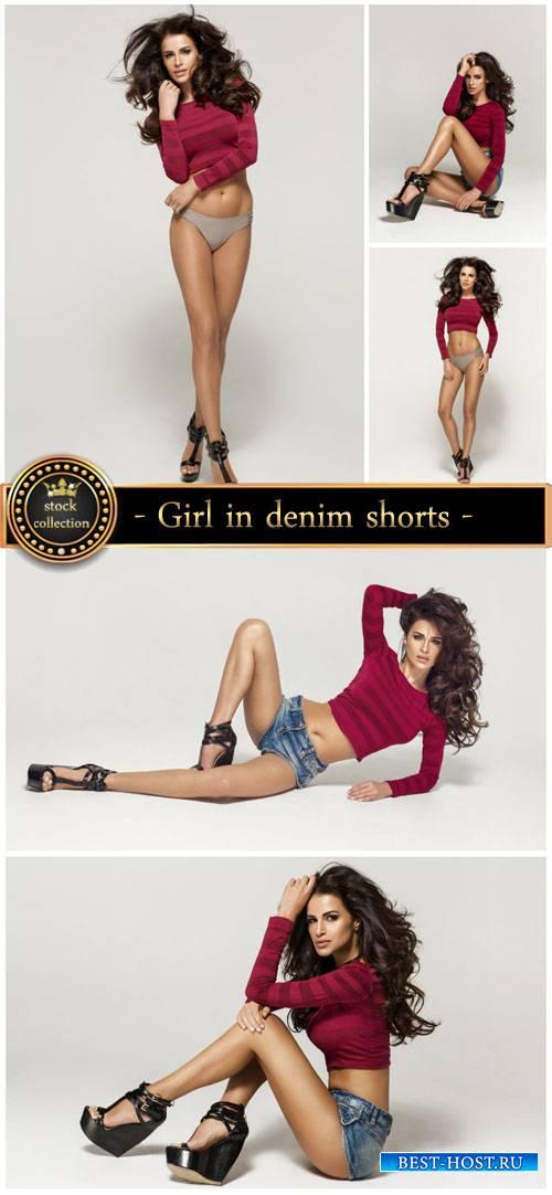 Girl in denim shorts - stock photos