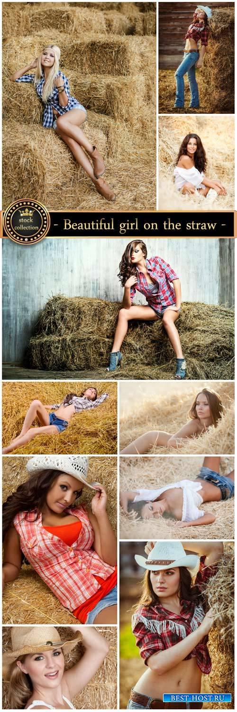 Beautiful girl on the straw - stock photos