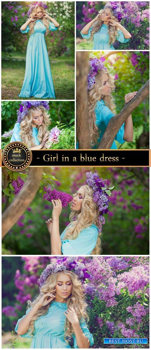 Girl in a blue dress, lilac bushes - stock photos