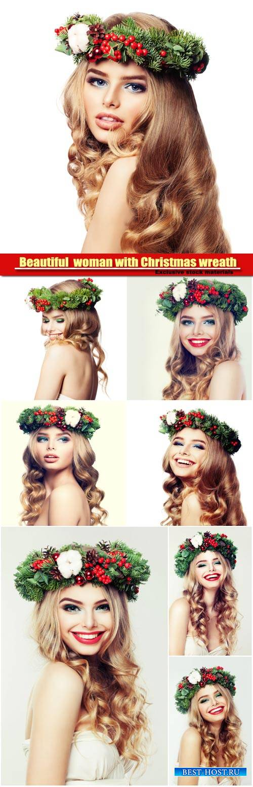 Happy beautiful  woman with Christmas wreath