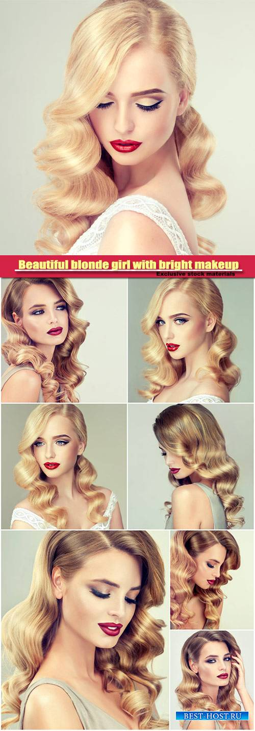 Beautiful blonde girl with bright makeup, with red lips, curly hair, stylin ...