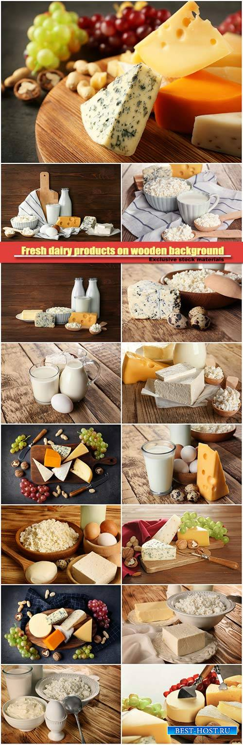 Fresh dairy products on wooden background, cheese and nuts