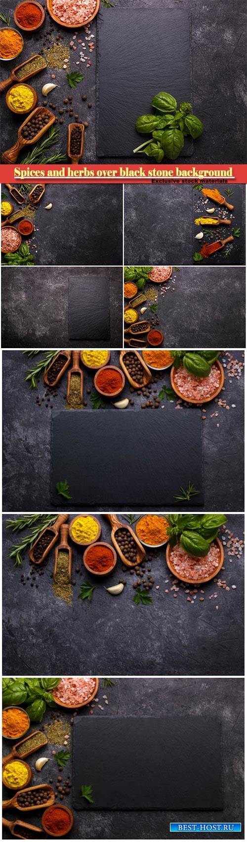 Spices and herbs over black stone background, top view with free space for  ...