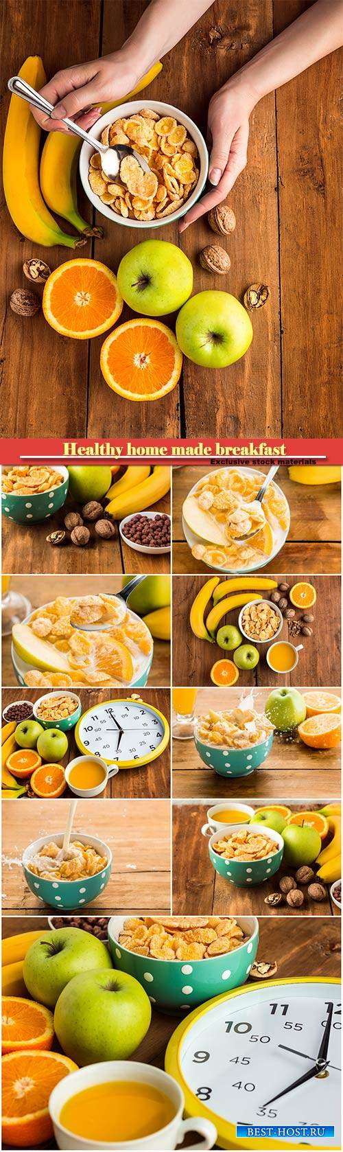 Healthy home made breakfast of muesli with female hands, apples, fresh frui ...
