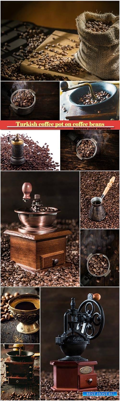 Turkish coffee pot on coffee beans, coffee mill