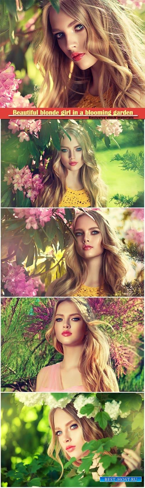 Beautiful blonde girl in a blooming garden