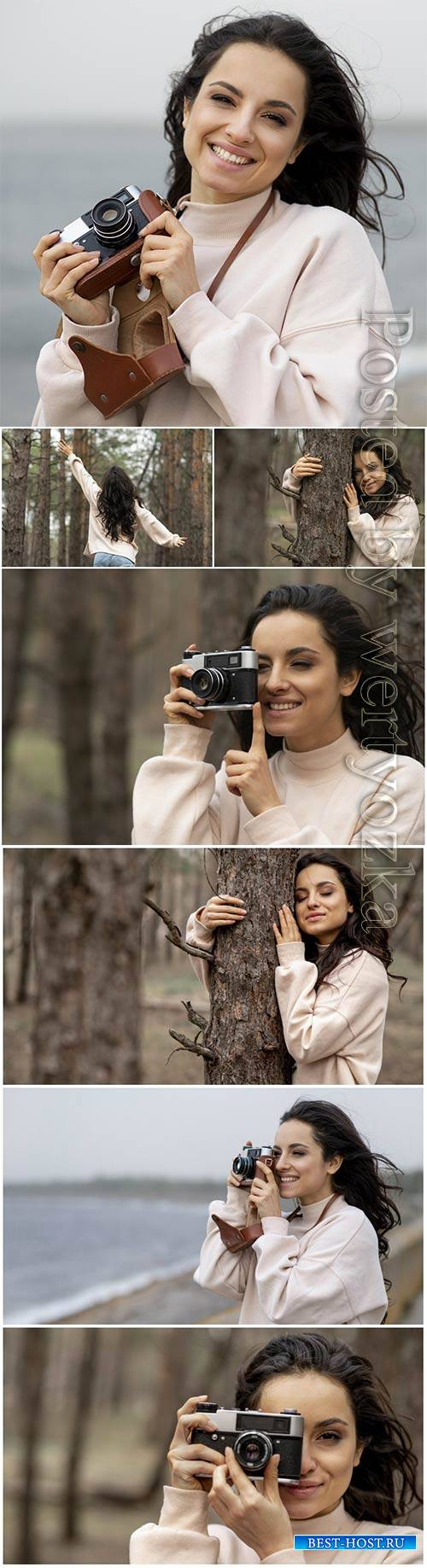 Smiley woman with camera