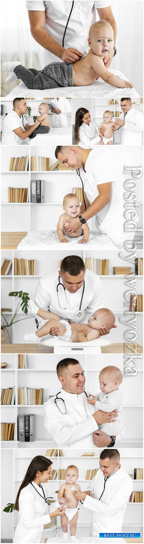 Doctor hands listening little baby stock photo