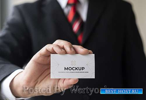 Close-up businessman holding business card mock-up with one hand