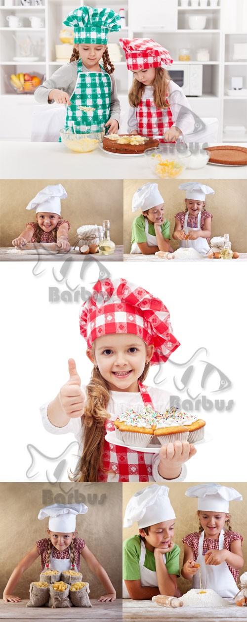 Happy little chef / Веселые маленькие поварята - Photo stock