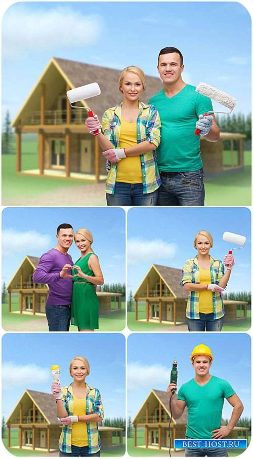 Ремонт дома, мужчина и женщина / Home repair, man and woman - Stock Photo