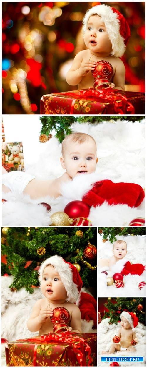 Ребенок у новогодней елки / Child have a Christmas tree - Stock Photo