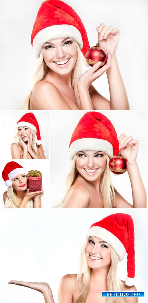 Beautiful blonde girl in santa hat - Christmas stock photos