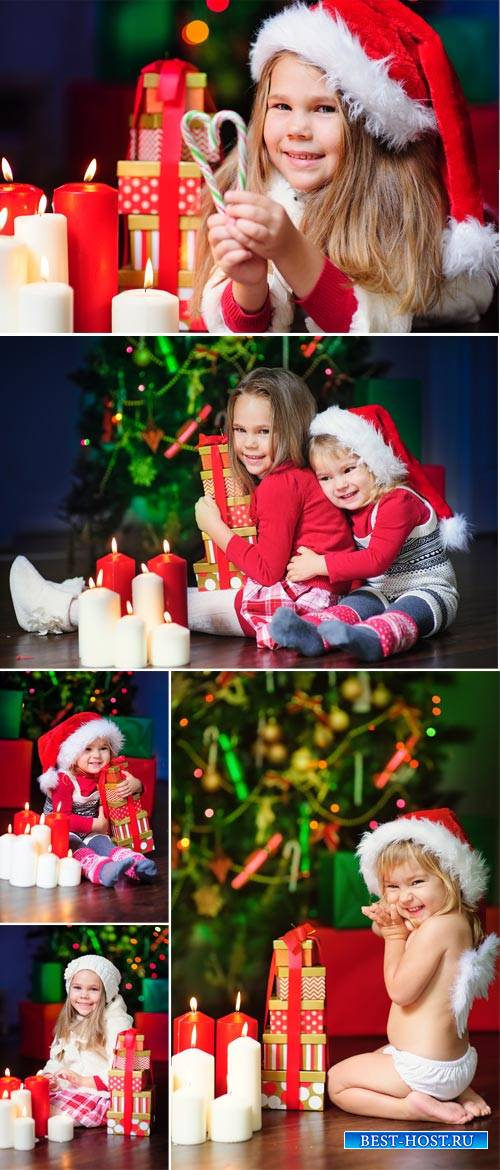 Small children have a Christmas tree - Stock Photo