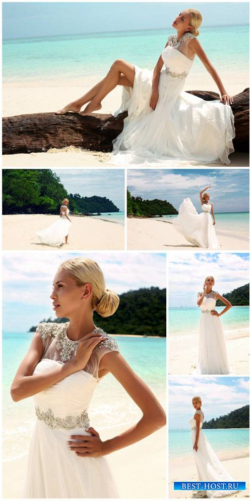 Bride on the beach - wedding stock photos