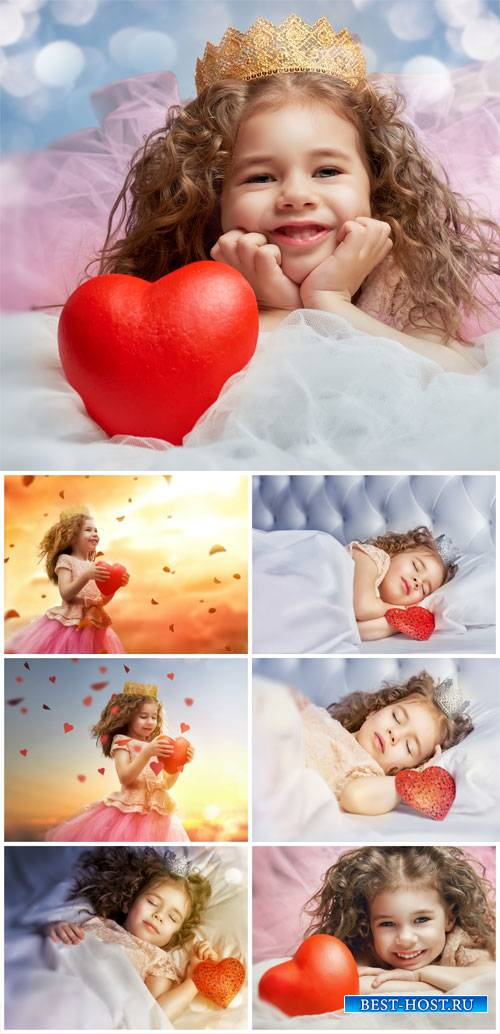 Little girl with heart - stock photos
