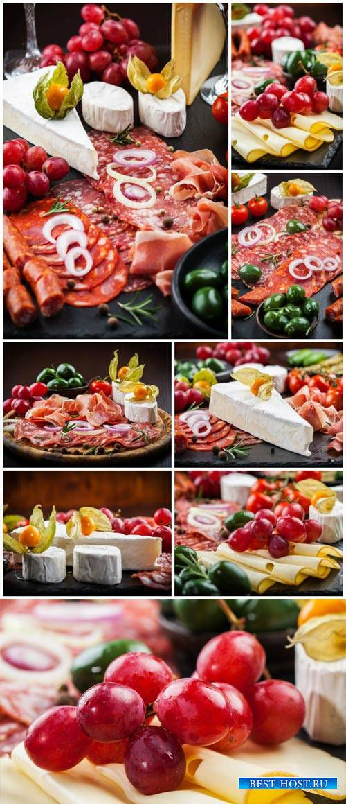 Meat products, cheese, grapes - stock photos