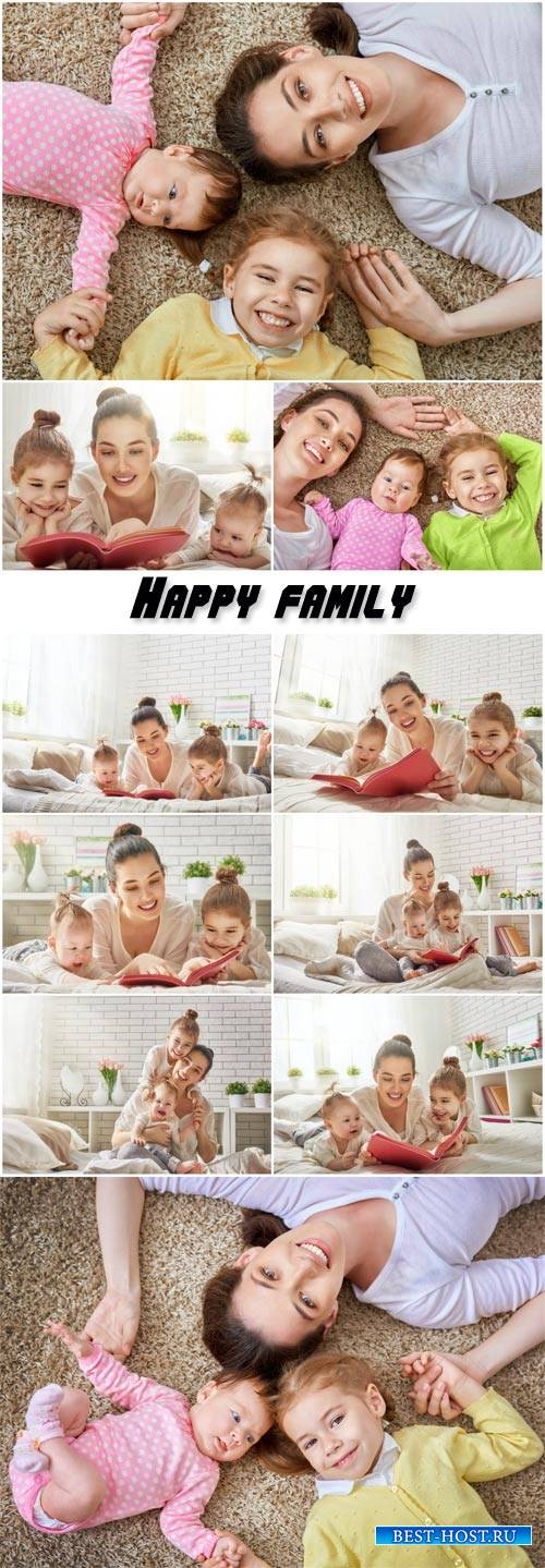 Happy family, mother reading a book