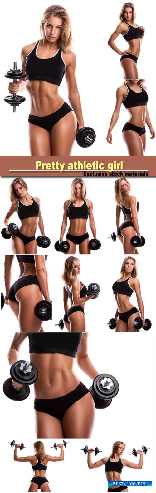 Pretty athletic girl with dumbbells
