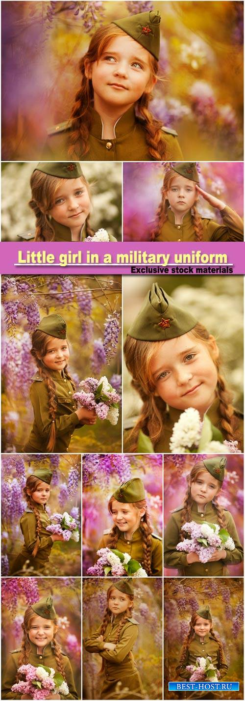 Cute little girl in a military uniform