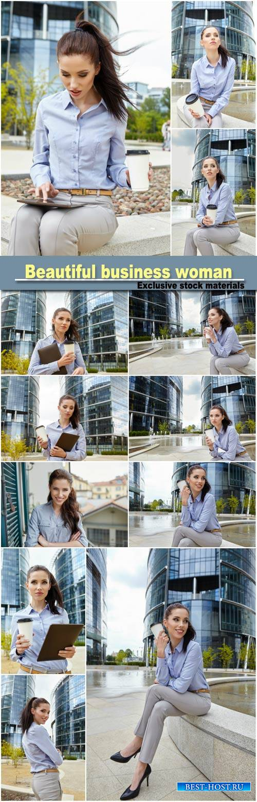 Beautiful business woman on the background of the modern office