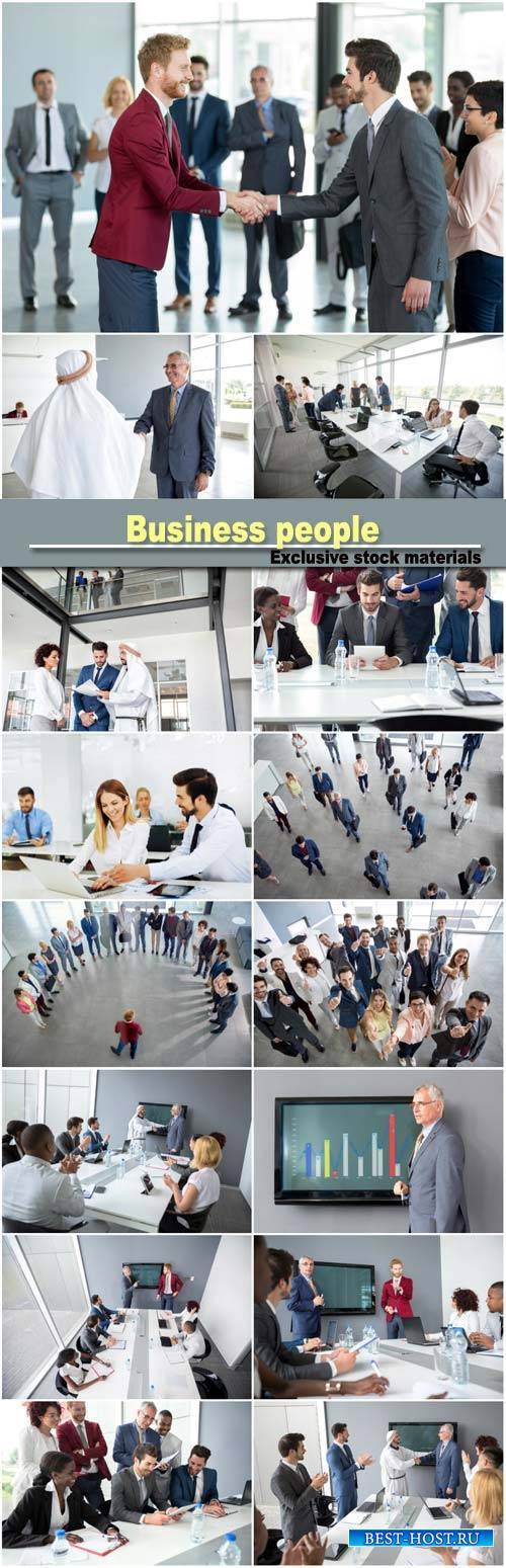 Business partners handshaking, successful adult business people
