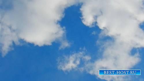 Футаж -  Белые облака на синем небе