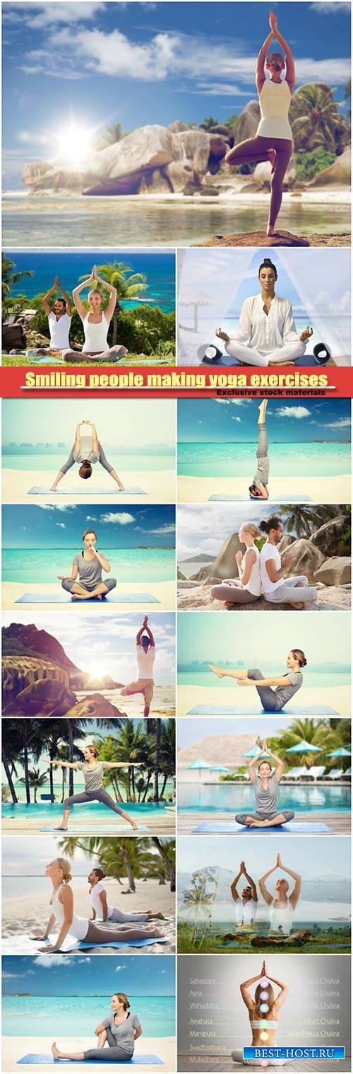 Smiling people making yoga exercises