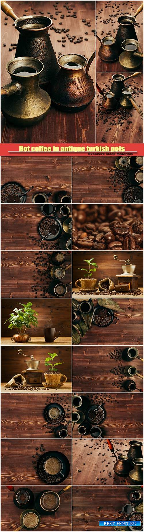 Hot coffee in antique turkish pots, beans on brown old wooden board backgro ...
