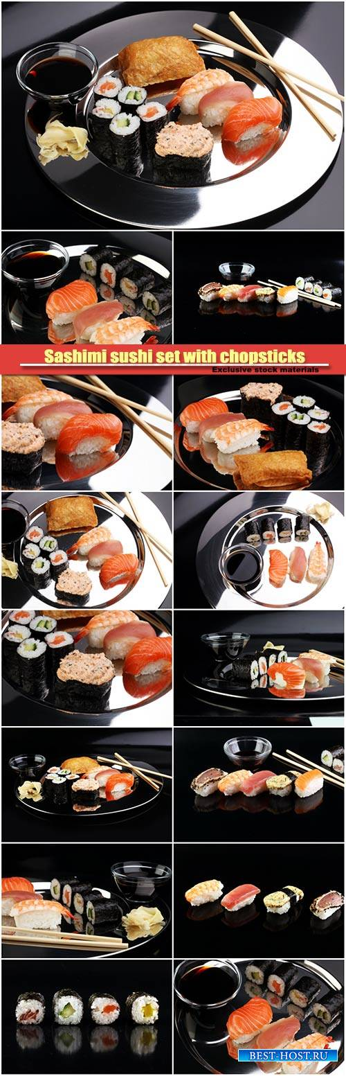 Sashimi sushi set with chopsticks and soy, sushi roll with salmon