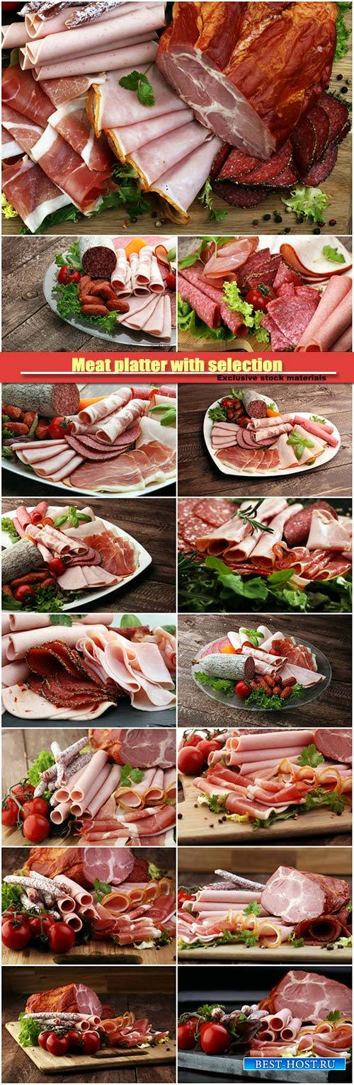 Meat platter with selection, salami, pieces of sliced ham, sausage, tomatoe ...