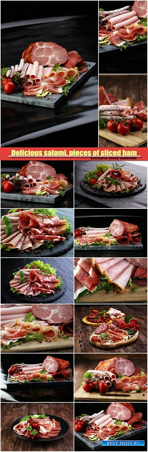 Delicious salami, pieces of sliced ham, sausage, tomatoes, salad and vegeta ...