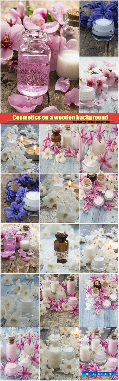 Cosmetics on a wooden background with spring flowers