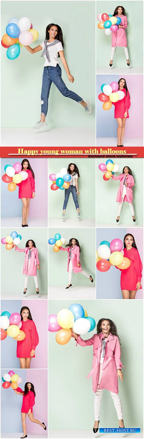 Happy young woman with balloons
