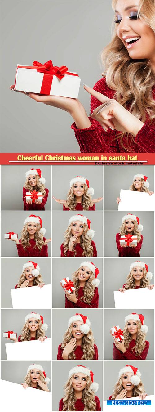 Cheerful Christmas woman in santa hat with white banner background