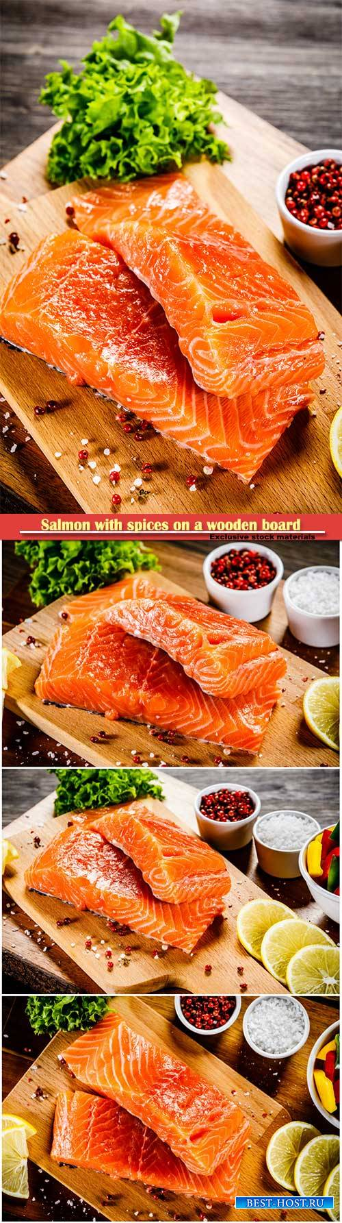 Salmon with spices on a wooden board