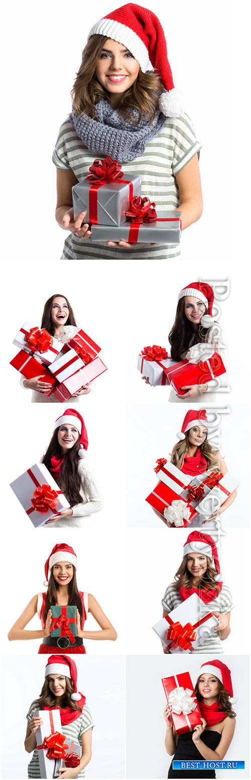 Girls in santa costume with gifts