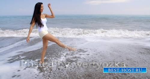 Videohive - Carefree Woman Kicking Up Water On Tropical Beach -  11694195