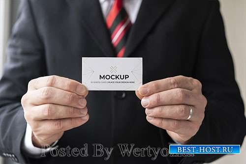 Businessman holding business card mock-up with both hands